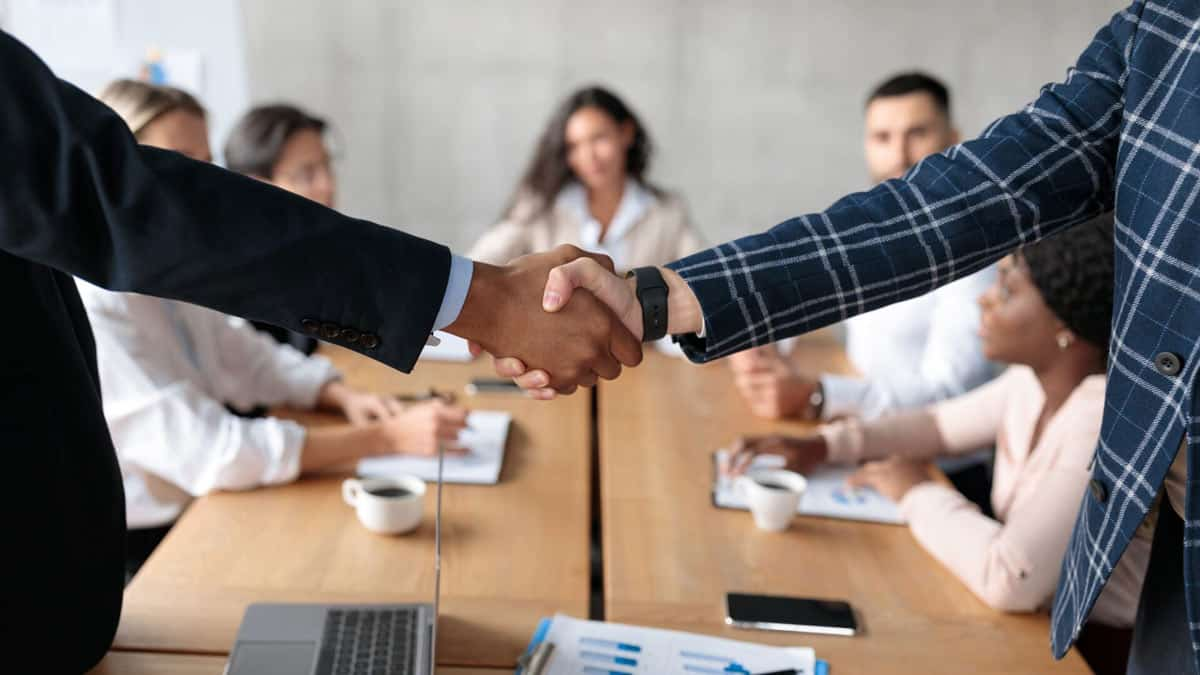 Handshake At Business Meeting, Two Businessmen Shaking Hands In Office